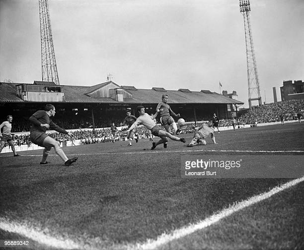 Chelsea player Alan Birchenall just beats the sliding tackles of Everton's Brian Labone and Howard Kendall during a First Division game at Stamford...