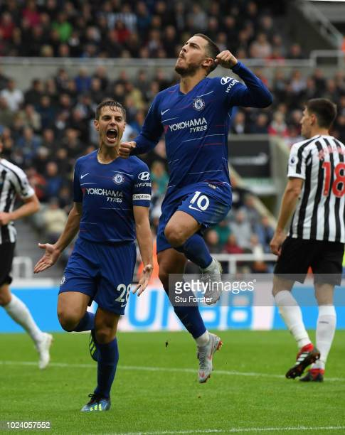 Chelsea player Eden Hazard celebrates with team mates after scoring the first chelsea goal during the Premier League match between Newcastle United...