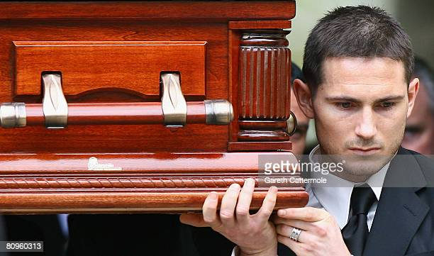 Chelsea player Frank Lampard carries the coffin of his mother Pat after her funeral at St Margaret's Church on May 2 2008 in Barking England