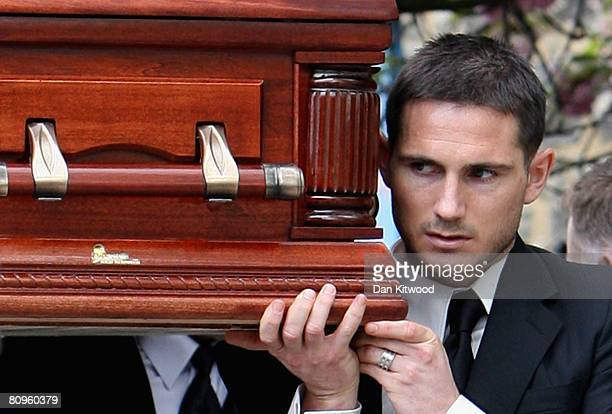 Chelsea player Frank Lampard carries the coffin out of the church at the funeral of his mother Pat at St Margaret's church in Barking on May 2 2008...