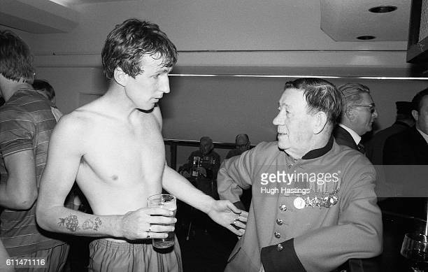 Chelsea player Joey Jones with a Chelsea Pensioner in the Chelsea Executive Club bar at Stamford Bridge after Chelsea beat Leeds United at home to...