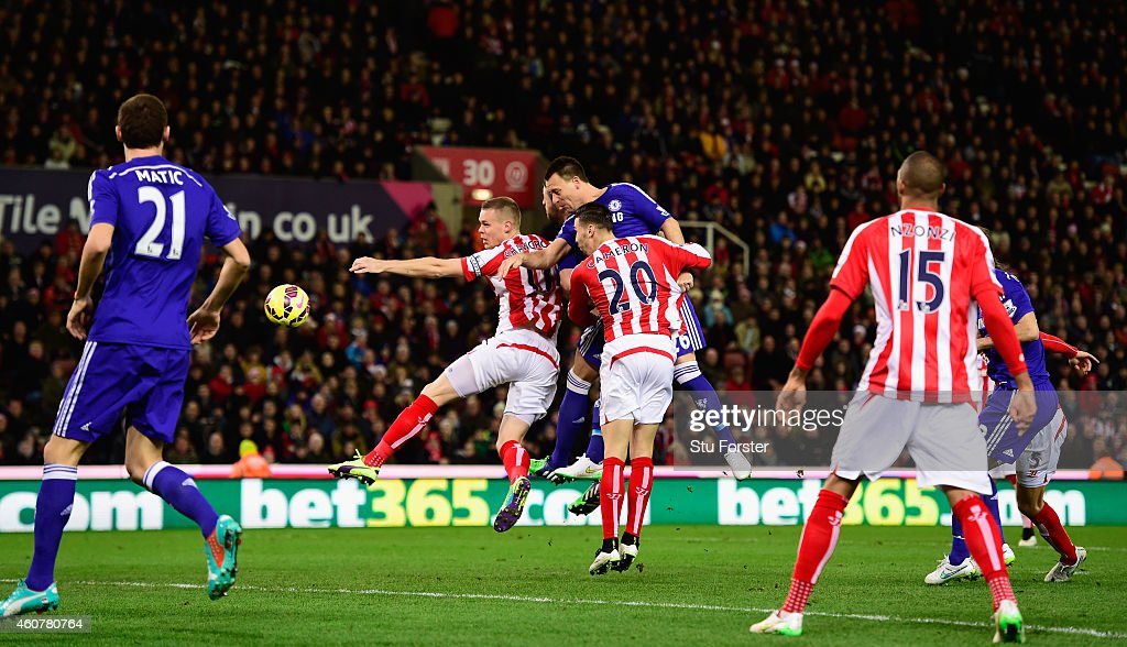 Chelsea player John Terry (c) heads in the opening goal during the Barclays Premier League match between Stoke City and Chelsea at Britannia Stadium on December 22, 2014 in Stoke on Trent, England.