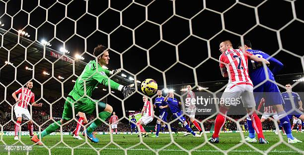 Chelsea player John Terry heads in the opening goal past Stoke goalkeeper Asmir Begovic during the Barclays Premier League match between Stoke City...