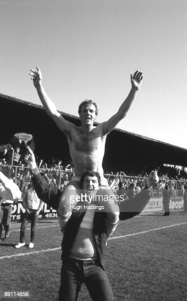 Chelsea player Kerry Dixon and a fan celebrate winning the Second Division Championship after the English Division Two match between Grimsby Town and...
