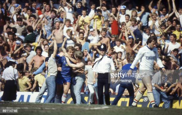 Chelsea player Kerry Dixon is mobbed by fans coming onto the pitch from the lower tier of the East Stand after Chelsea scored during the English...