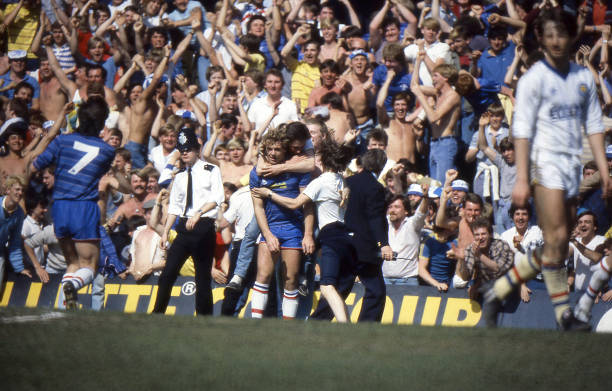 Chelsea player Kerry Dixon is mobbed by fans coming onto the pitch from the lower tier of the East Stand, after Chelsea scored during the English...
