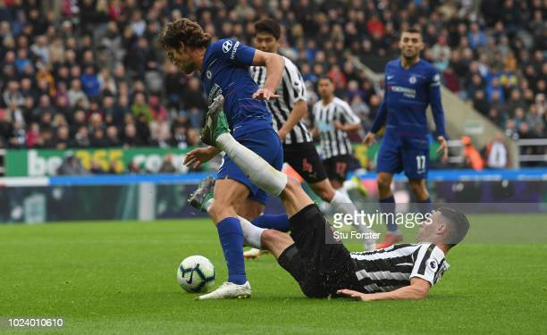 Chelsea player Marcos Alonso is fouled by Newcastle defender Fabian Schar to give Chelsea a penalty during the Premier League match between Newcastle...