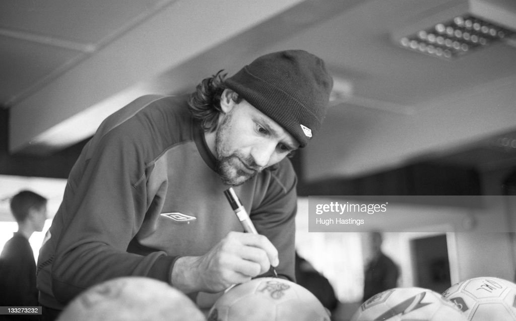 Chelsea player Mario Stanic signs football's for fans during the 2002/03 Pre-Season in August 2002 at Chelsea FC's training ground at Harlington, in London, England.