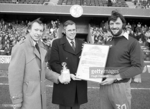 Chelsea player Micky Droy receives an award to mark his 200th first team game before the Division 2 match against Cambridge United on February 7 1981...