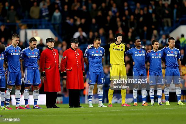 Chelsea players and Chelsea Pensioners observe a one minute silence in honour of Remembrance Day prior to kickoff during the Barclays Premier League...