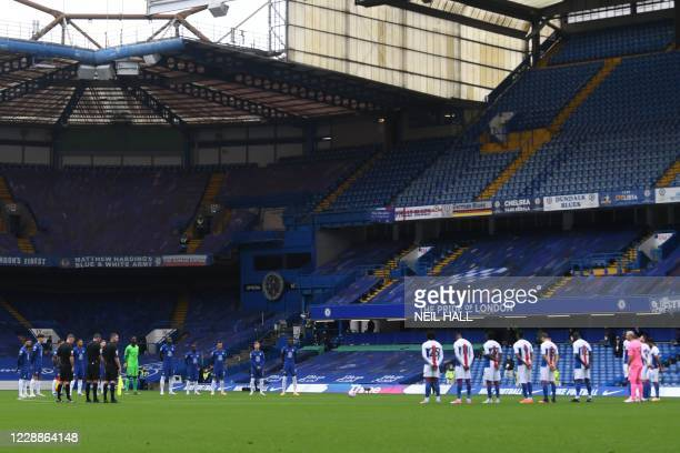 Chelsea players and Crystal Palace players hold a minute's silence for police officer Ratana who was killed on duty, before the English Premier...