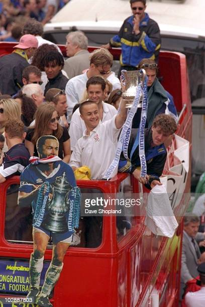 Chelsea players and fans celebrate victory during an open top bus parade celebrating the club winning the 1997 FA Cup Final between Chelsea and...