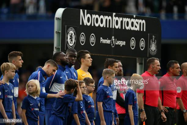 Chelsea players and match officials line up as a No Room for Racism board is seen prior to the Premier League match between Chelsea FC and Newcastle...