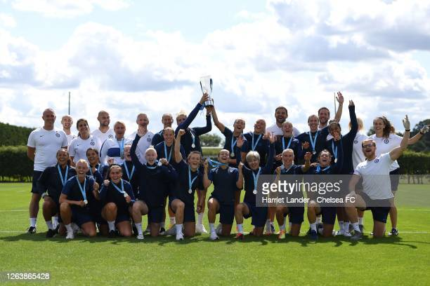 Chelsea players and staff celebrate with the Barclays FA Women's Super League trophy and their winners medals prior to a Chelsea FC Women's Training...