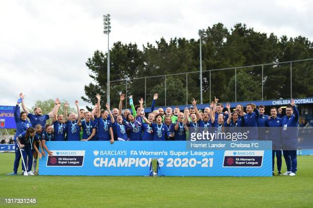 Chelsea players and staff celebrate with the Barclays FA Women's Super League Trophy following their team's victory in the Barclays FA Women's Super...