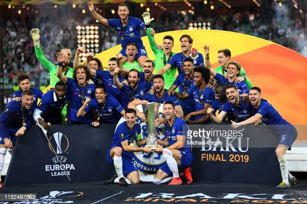 Chelsea players and staff celebrate with the UEFA Europa League Trophy following their sides victory in the UEFA Europa League Final between Chelsea...