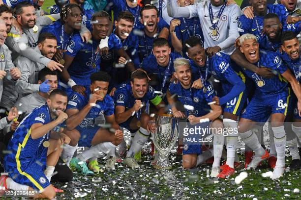 Chelsea players and staff pose with the trophy during the presentation ceremony after Chelsea won the UEFA Super Cup football match between Chelsea...