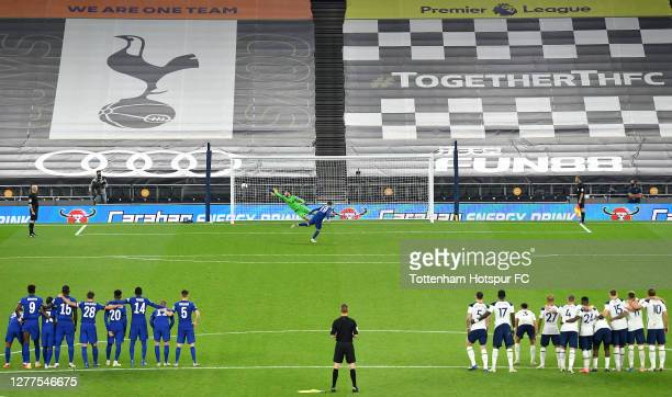 Chelsea players and Tottenham Hotspur players look on as Mason Mount of Chelsea misses his team's fifth penalty in a penalty shoot out, meaning...