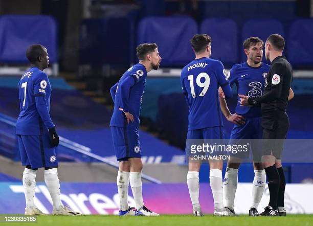 Chelsea players appeal to English referee Stuart Attwell after they concede their first goal during the English Premier League football match between...