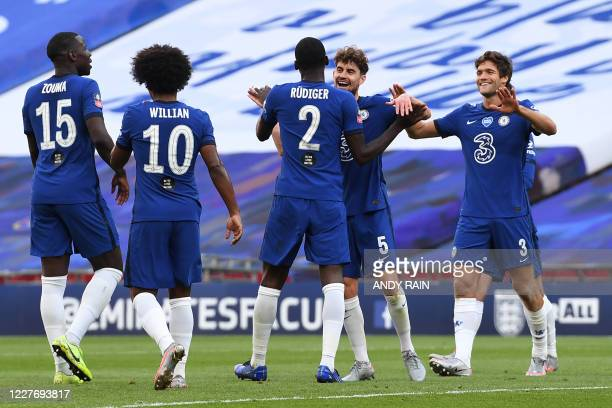 Chelsea players celebrate after Manchester United's English defender Harry Maguire deflects the ball into his own net for Chelsea's third goal during...