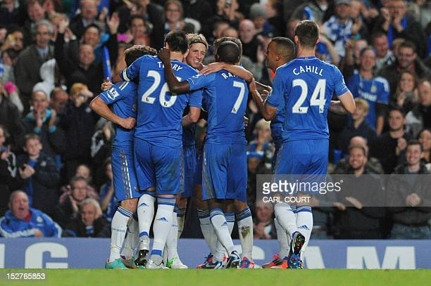Chelsea players celebrate after Spanish striker Fernando Torres scored against Wolverhampton Wanderers during the third round English League Cup...