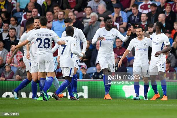 Chelsea players celebrate after their sides first goal an own goal by Burnley's Kevin Long during the Premier League match between Burnley and...
