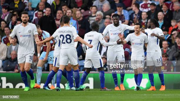 Chelsea players celebrate after their sides first goal during the Premier League match between Burnley and Chelsea at Turf Moor on April 19 2018 in...
