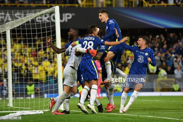 Chelsea players celebrate after winning the UEFA Super Cup football match between Chelsea and Villarreal at Windsor Park in Belfast on August 11,...