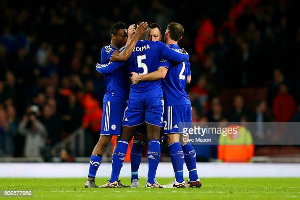 Chelsea players celebrate at the final whistle during the Barclays Premier League match between Arsenal and Chelsea at Emirates Stadium on January 24...