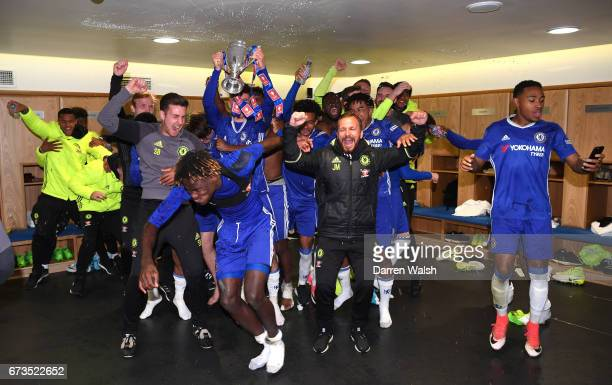 Chelsea Players Celebrate In The Dressing Room With Trophy Following Victory FA Youth