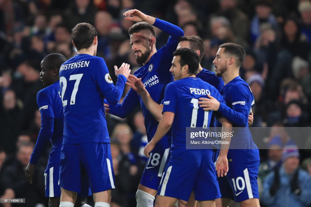 Chelsea players celebrate scoring their 1st goal during the Premier League match between Chelsea and West Bromwich Albion at Stamford Bridge on February 12, 2018 in London, England.