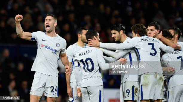 Chelsea players celebrate the fourth goal scored by Eden Hazard as Gary Cahill salutes the fans during the Premier League match between West Bromwich...