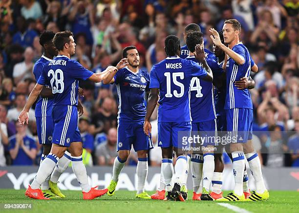 Chelsea players celebrate the opening goal scored by Michy Batshuayi during the EFL Cup second round match between Chelsea and Bristol Rovers at...