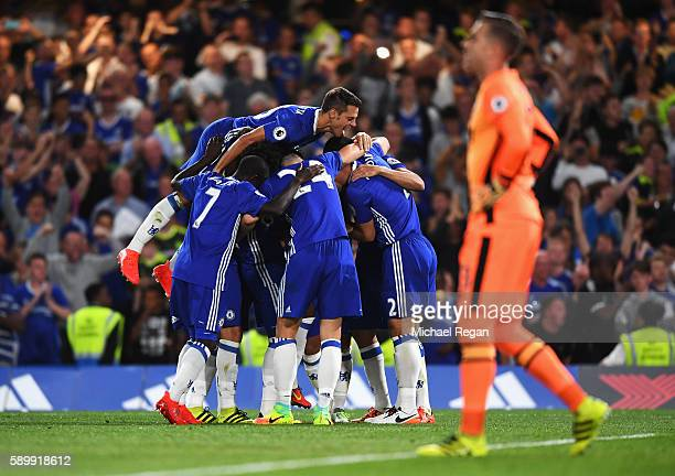 Chelsea players celebrate the penalty scored by Eden Hazard during the Premier League match between Chelsea and West Ham United at Stamford Bridge on...