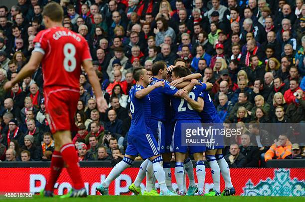 Chelsea players celebrate their equalising goal scored by Chelsea's English defender Gary Cahill as Liverpool's English midfielder Steven Gerrard...