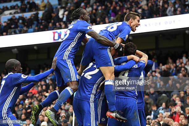 Chelsea players celebrate their team's third goal scored by Eden Hazard during the Premier League match between Manchester City and Chelsea at Etihad...