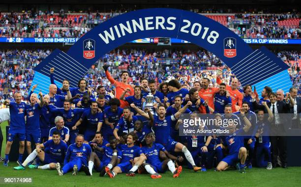 Chelsea players celebrate their win with the trophy during The Emirates FA Cup Final between Chelsea and Manchester United at Wembley Stadium on May...