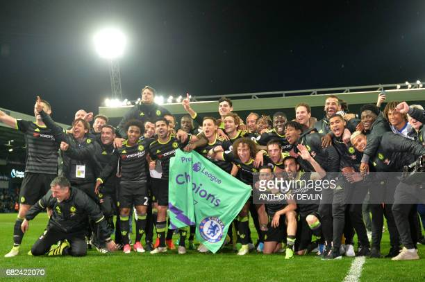 Chelsea players celebrate victory after the English Premier League match between West Bromwich Albion and Chelsea at The Hawthorns stadium in West...