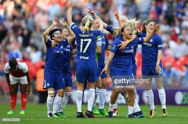 Chelsea players celebrate winning the SSE Women's FA Cup Final match between Arsenal Women and Chelsea Ladies at Wembley Stadium on May 5 2018 in...