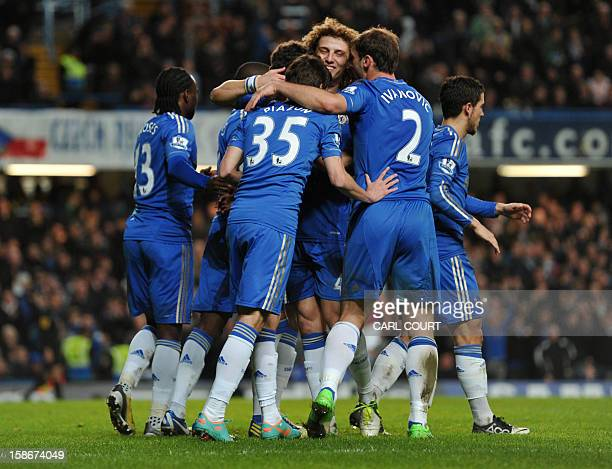 Chelsea players celebrate with Brazilian midfielder Oscar after he scores the sixth goal during the English Premier League football match between...