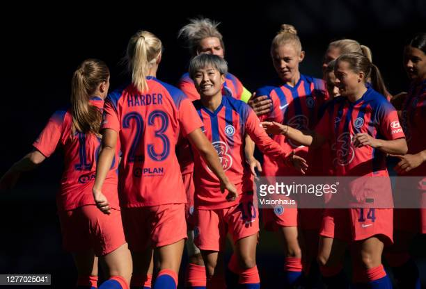 Chelsea players celebrate with goalscorer Erin Cuthbert after she scores their goal during the Womens FA Cup Quarter Final match between Everton FC...
