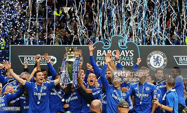 Chelsea players celebrate with the Barclays Premier League trophy after Chelsea win the title with a 80 victory over Wigan Athletic in the English...