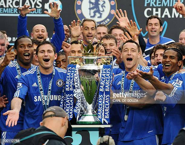 Chelsea players celebrate with the Barclays Premier League trophy after Chelsea win the title with a 8-0 victory over Wigan Athletic in the English...