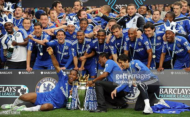 Chelsea players celebrate with the Barclays Premier League trophy after they win the title with a 80 victory over Wigan Athletic in the English...