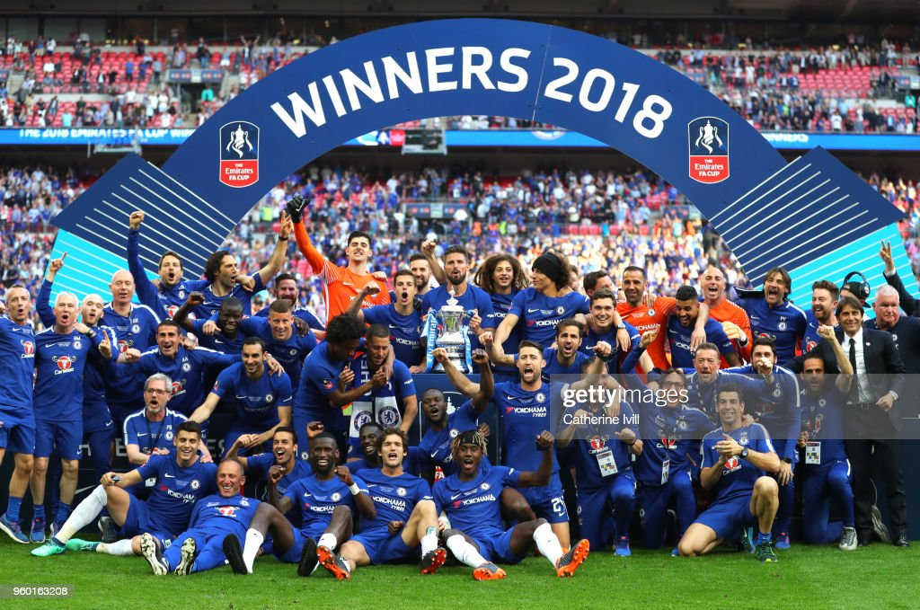 Chelsea players celebrate with the Emirates FA Cup Trophy following their sides victory in The Emirates FA Cup Final between Chelsea and Manchester United at Wembley Stadium on May 19, 2018 in London, England.