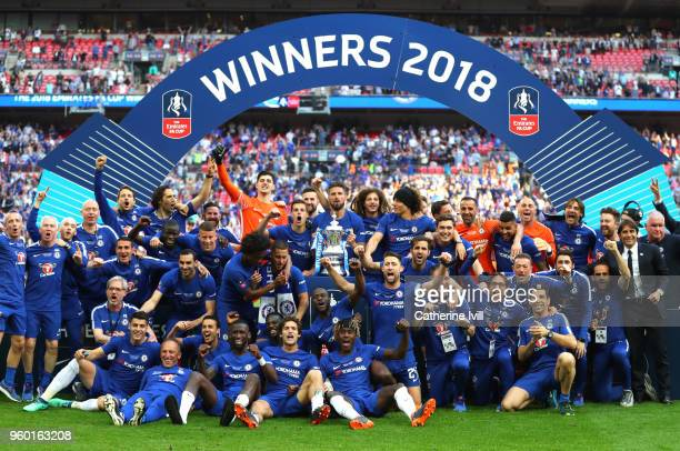 Chelsea players celebrate with the Emirates FA Cup Trophy following their sides victory in The Emirates FA Cup Final between Chelsea and Manchester...