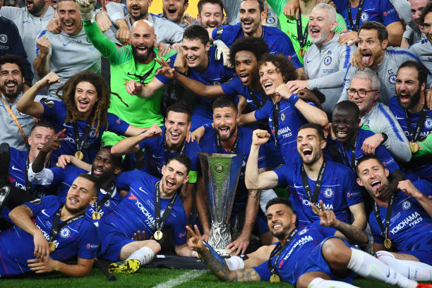 Ligue Europa 2018  - 2019 -2020 - Page 10 Chelsea-players-celebrate-with-the-europa-league-trophy-following-picture-id1152499753?k=6&m=1152499753&s=612x612&w=0&h=5aZxTEy1POzICaSMhr8UiAEeQhDV357V7Sw6G2F9isM=