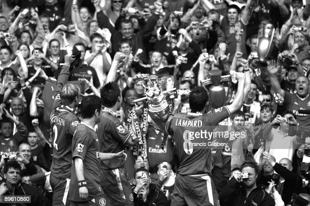 Chelsea players celebrate with the league trophy as they celebrate winning the league title after the FA Barclays Premiership match between Chelsea...