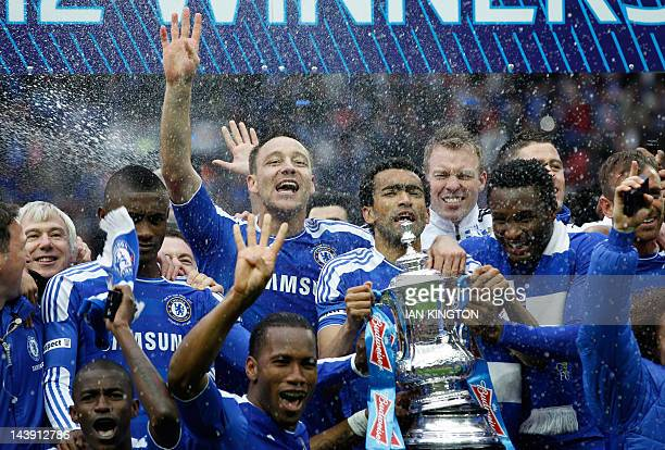 Chelsea players celebrate with the trophy after Chelsea's 21 win in the FA Cup final football match between Liverpool and Chelsea at Wembley Stadium...