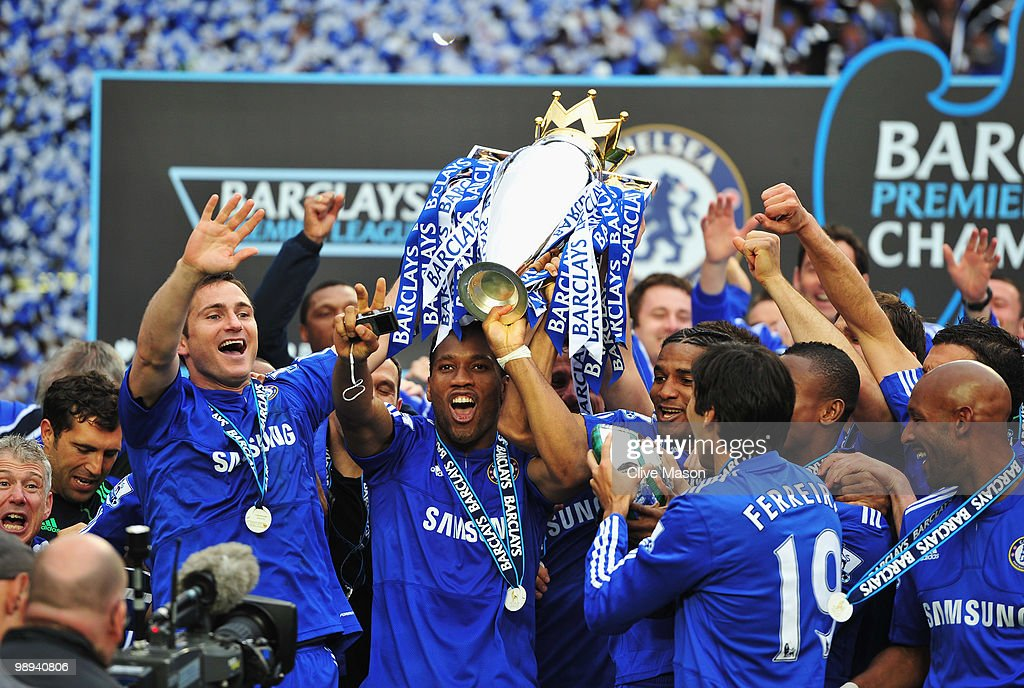 Chelsea players celebrate with the trophy after the Barclays Premier League match between Chelsea and Wigan Athletic at Stamford Bridge on May 9, 2010 in London, England. Chelsea won 8-0 to win the title.